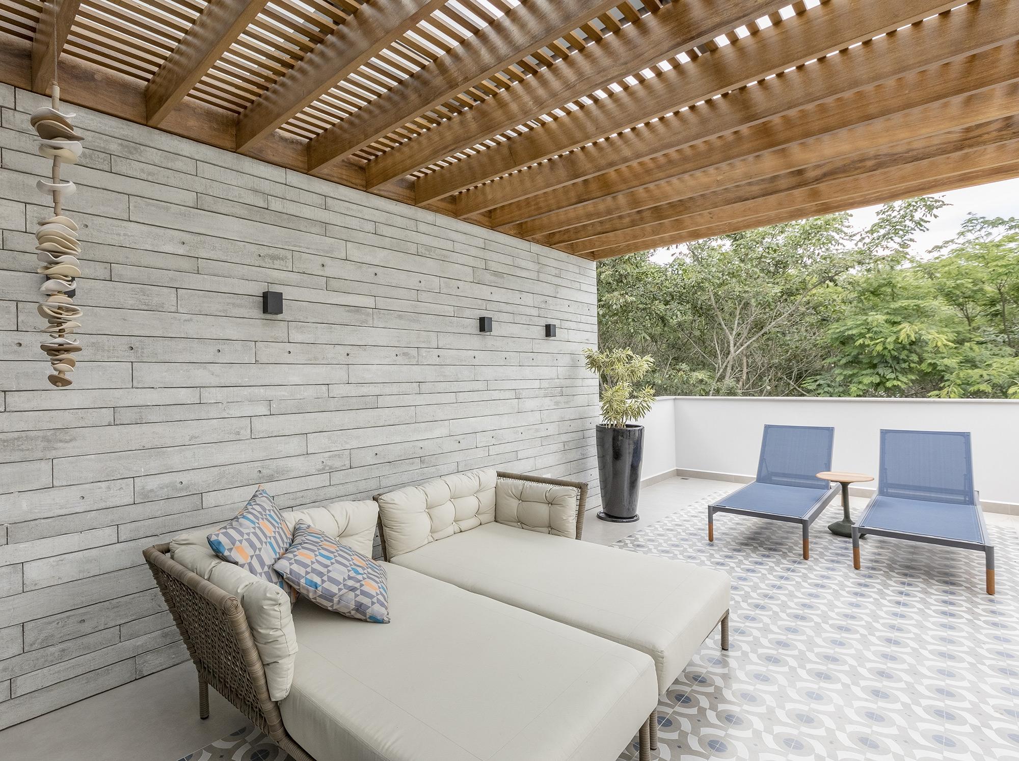 Revesimento Apparente no espaço de estar da Arquiteta Raquel Miyatake. Foto de Rita Bonanata