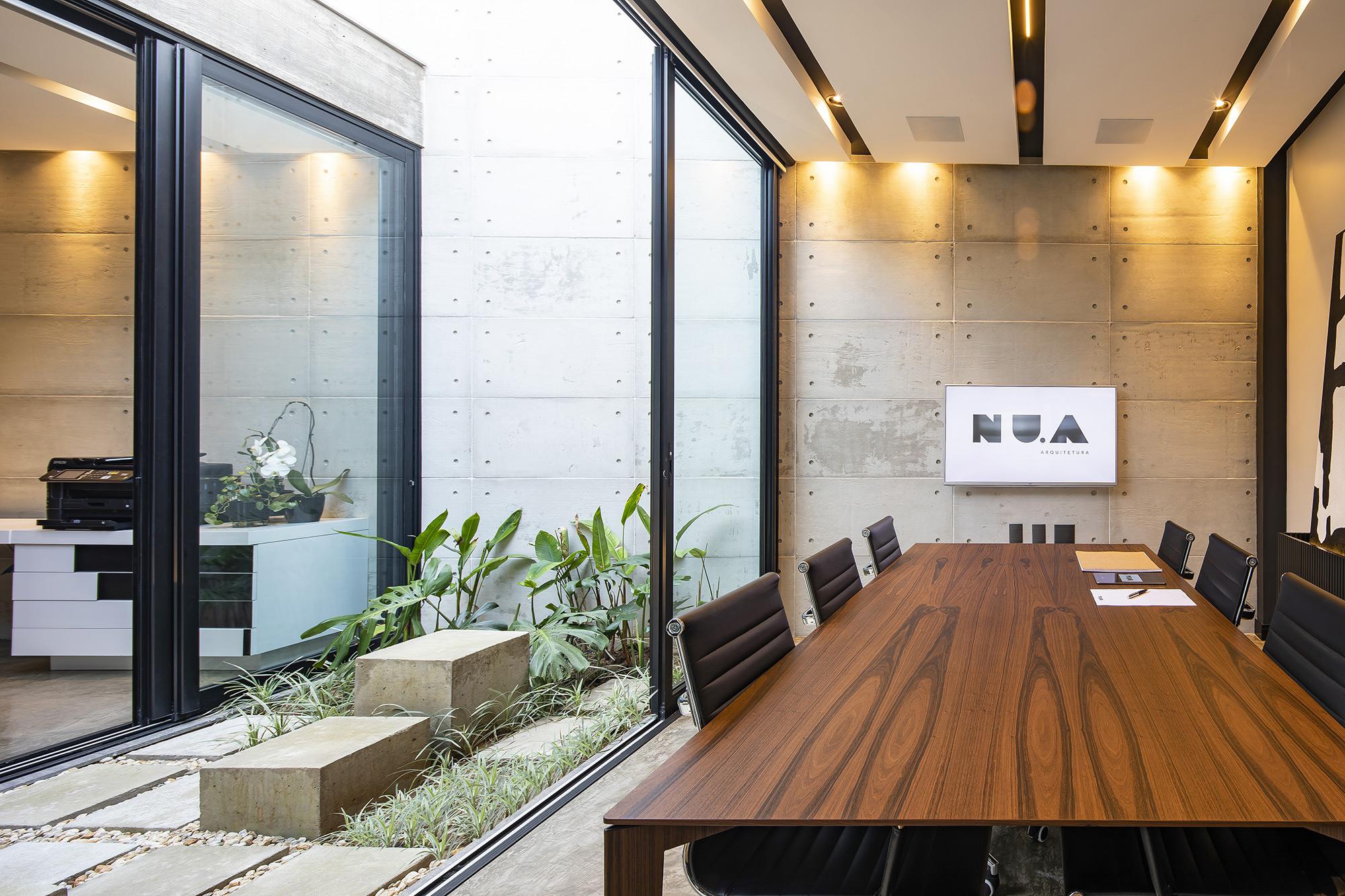 Revestimento Apparente no projeto da NU.A Arquitetura, com Foto de Renan Costantin